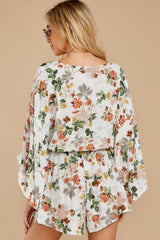 8 Edge Of A Dream Ivory Floral Print Romper at reddressboutique.com