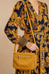 1 Hold The Phone Mustard Purse at reddressboutique.com