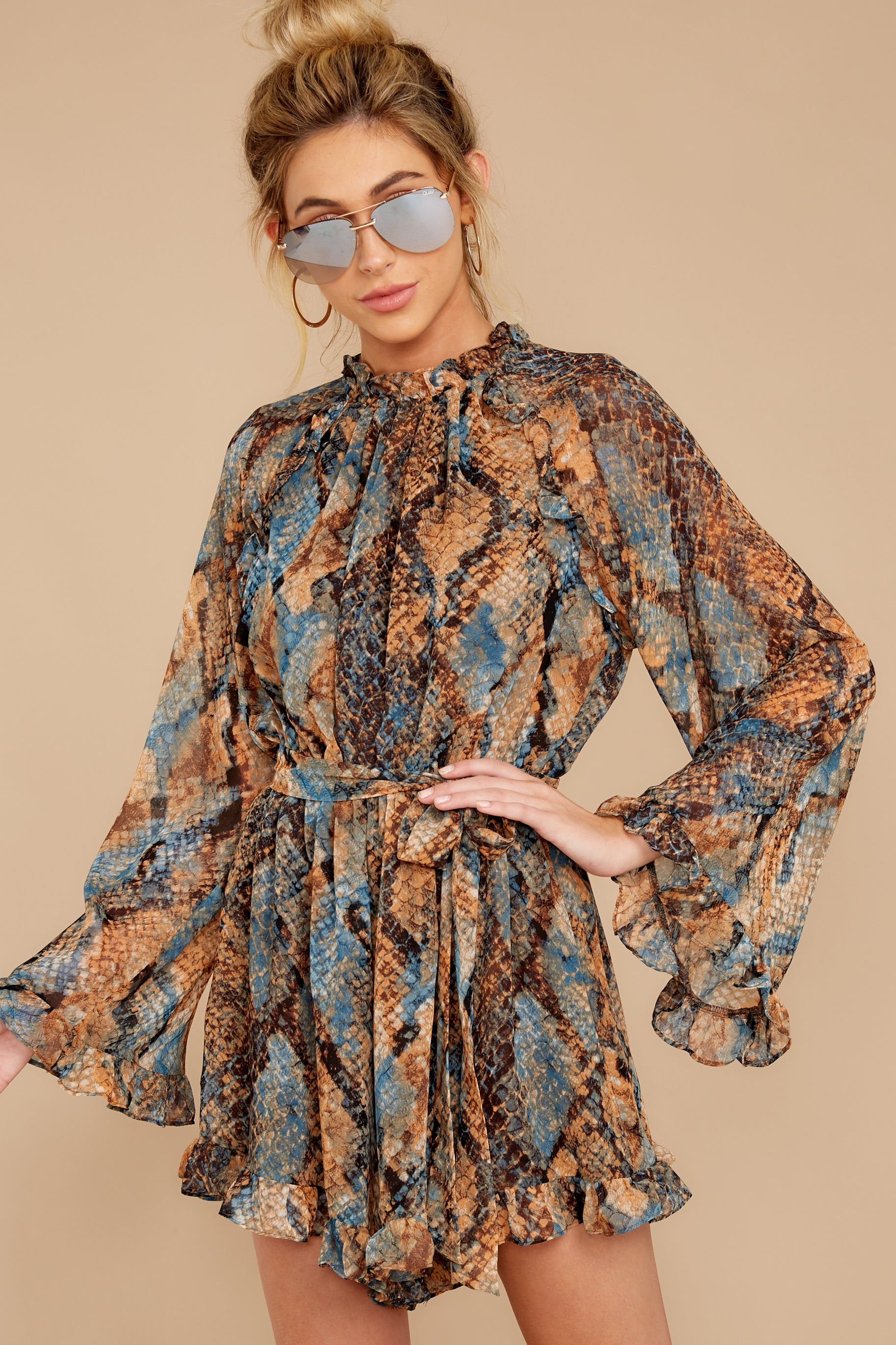 5 Know What To Expect Rust Orange Multi Snake Print Romper at reddressboutique.com