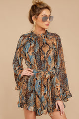 7 Know What To Expect Rust Orange Multi Snake Print Romper at reddressboutique.com