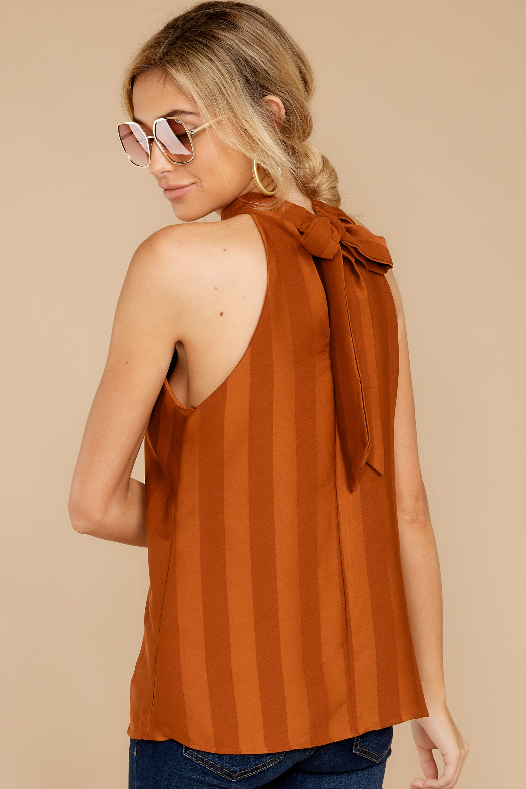 4 Hide And Chic Brown Top at reddressboutique.com