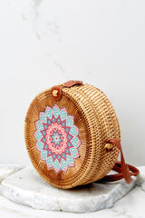 4 A Little Charmed Printed Tan Round Bag at reddressboutique.com