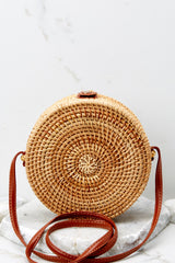 5 A Little Charmed Printed Tan Round Bag at reddressboutique.com