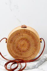 4 A Little Charmed Pink Printed Tan Round Bag at reddressboutique.com