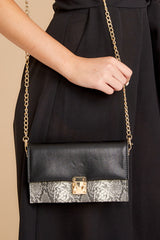 2 Waiting On Promises Black And Snake Skin Clutch at reddress.com