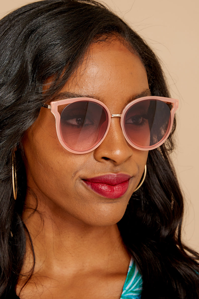 3 See Thunder Rose Fade Pink Sunglasses at reddressboutique.com