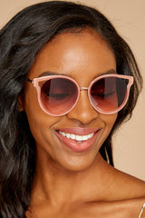 1 See Thunder Rose Fade Pink Sunglasses at reddressboutique.com