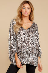 4 Let's Go Ivory Leopard Print Top at reddressboutique.com