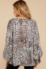 7 Let's Go Ivory Leopard Print Top at reddressboutique.com