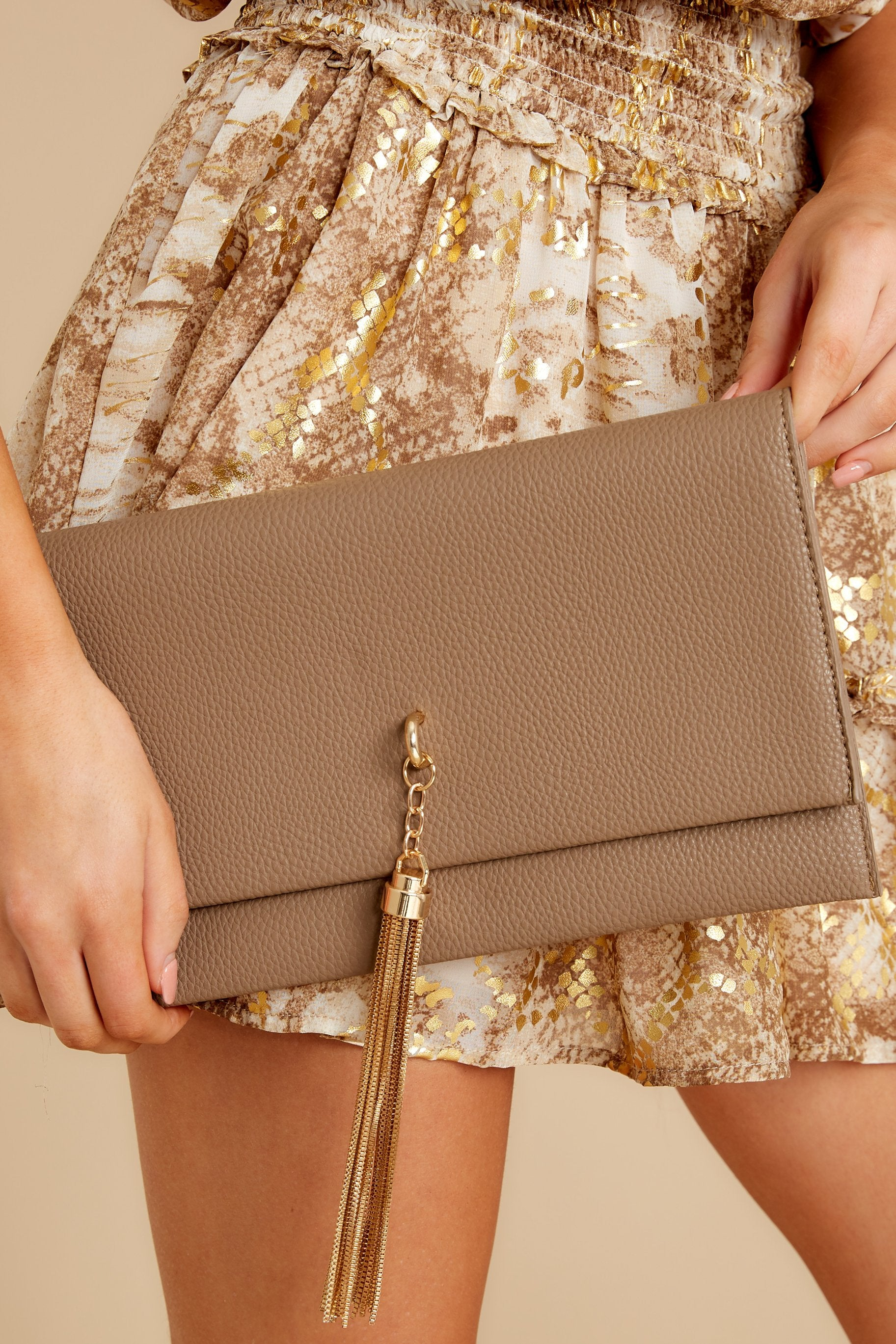 7 Stealing Hearts Brown Tasseled Clutch at reddressboutique.com