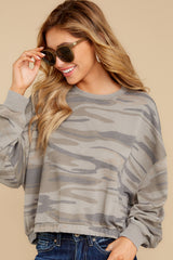 8 The Relaxed Light Sage Camo Pullover at reddressboutique.com