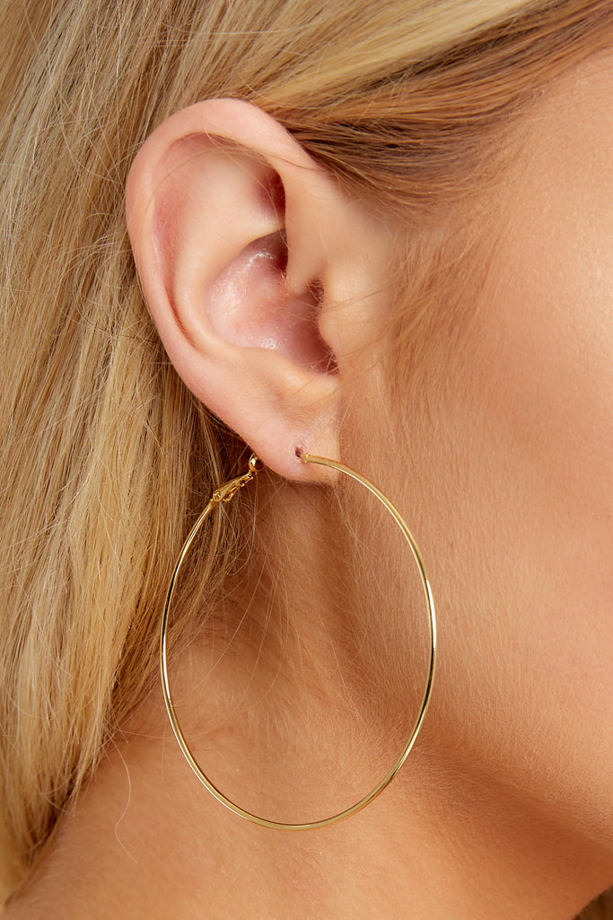 4 Best Believe It Gold Hoop Earrings at reddressboutique.com