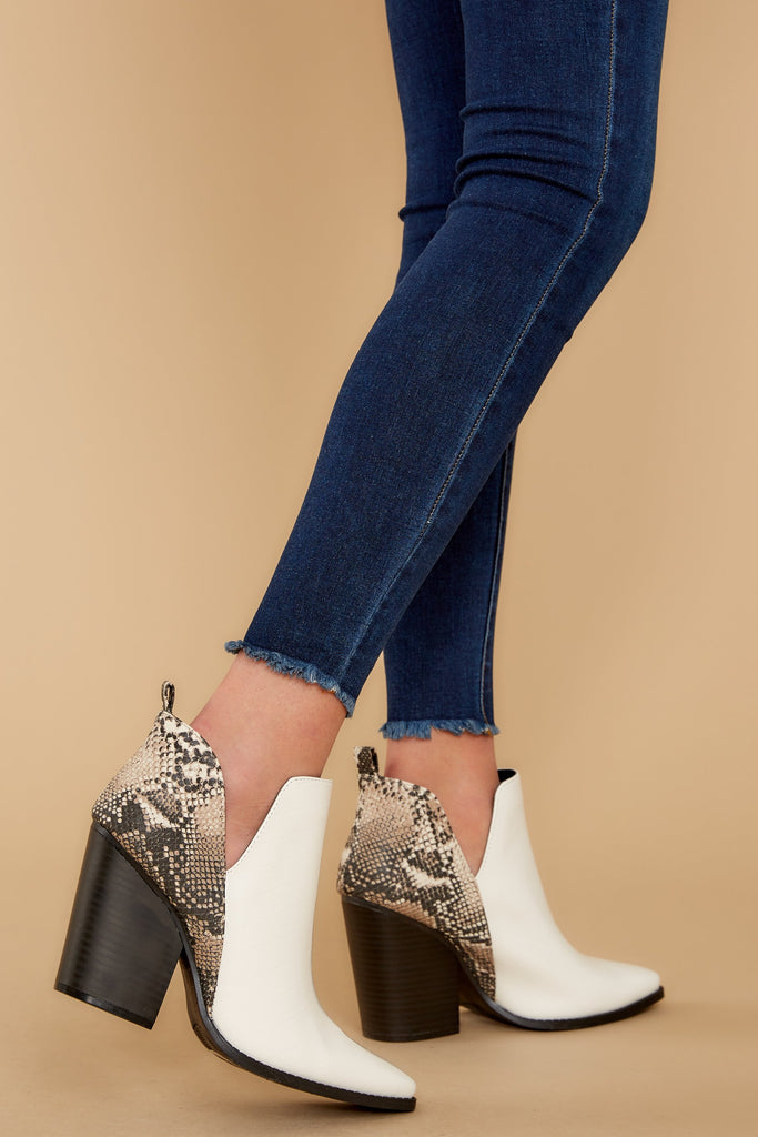 1 Sonni Snake Print Booties at reddressboutique.com