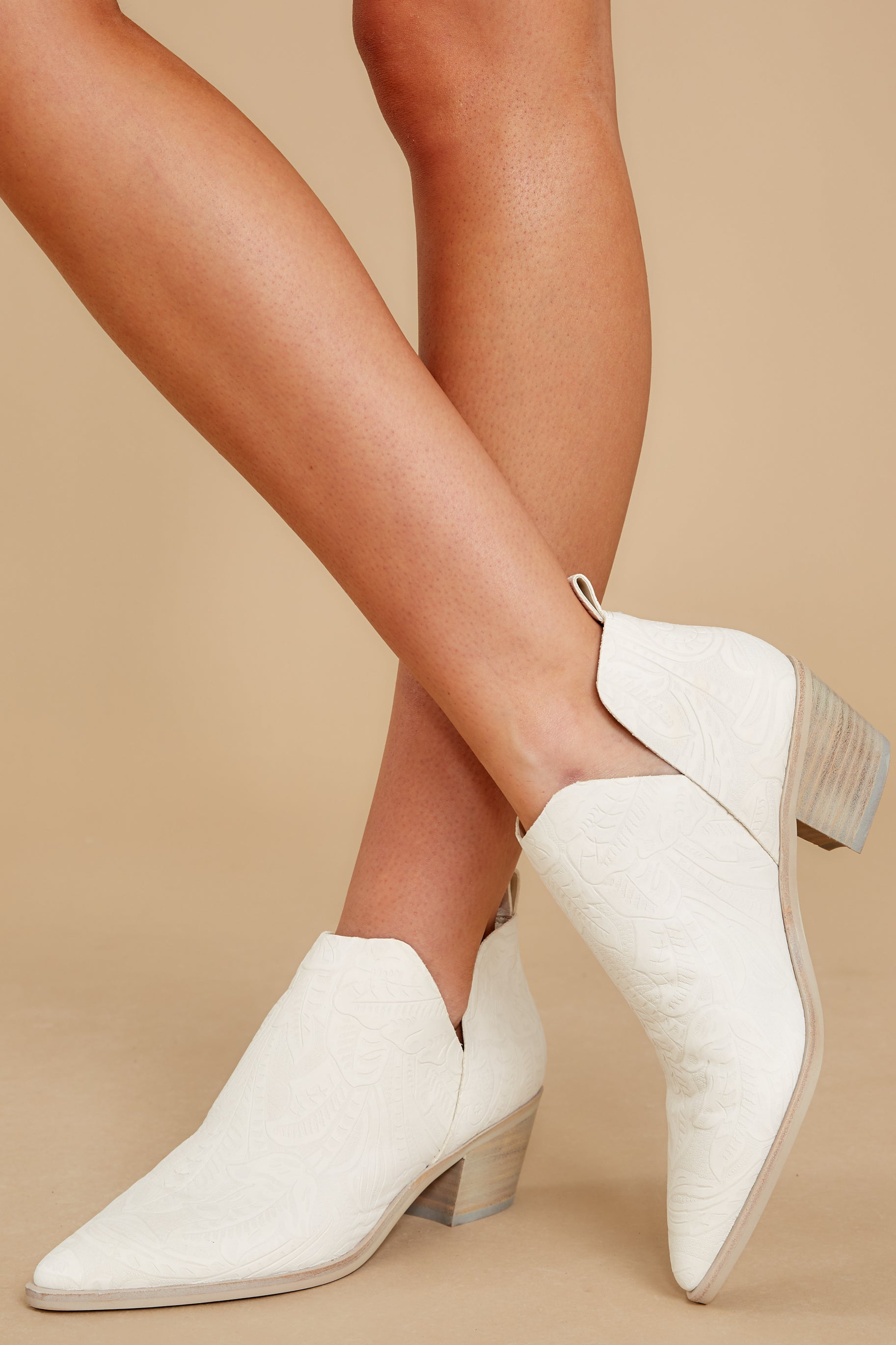 1 Sonni White Embossed Booties at reddress.com