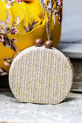 4 Add This Little Beige Clutch at reddressboutique.com