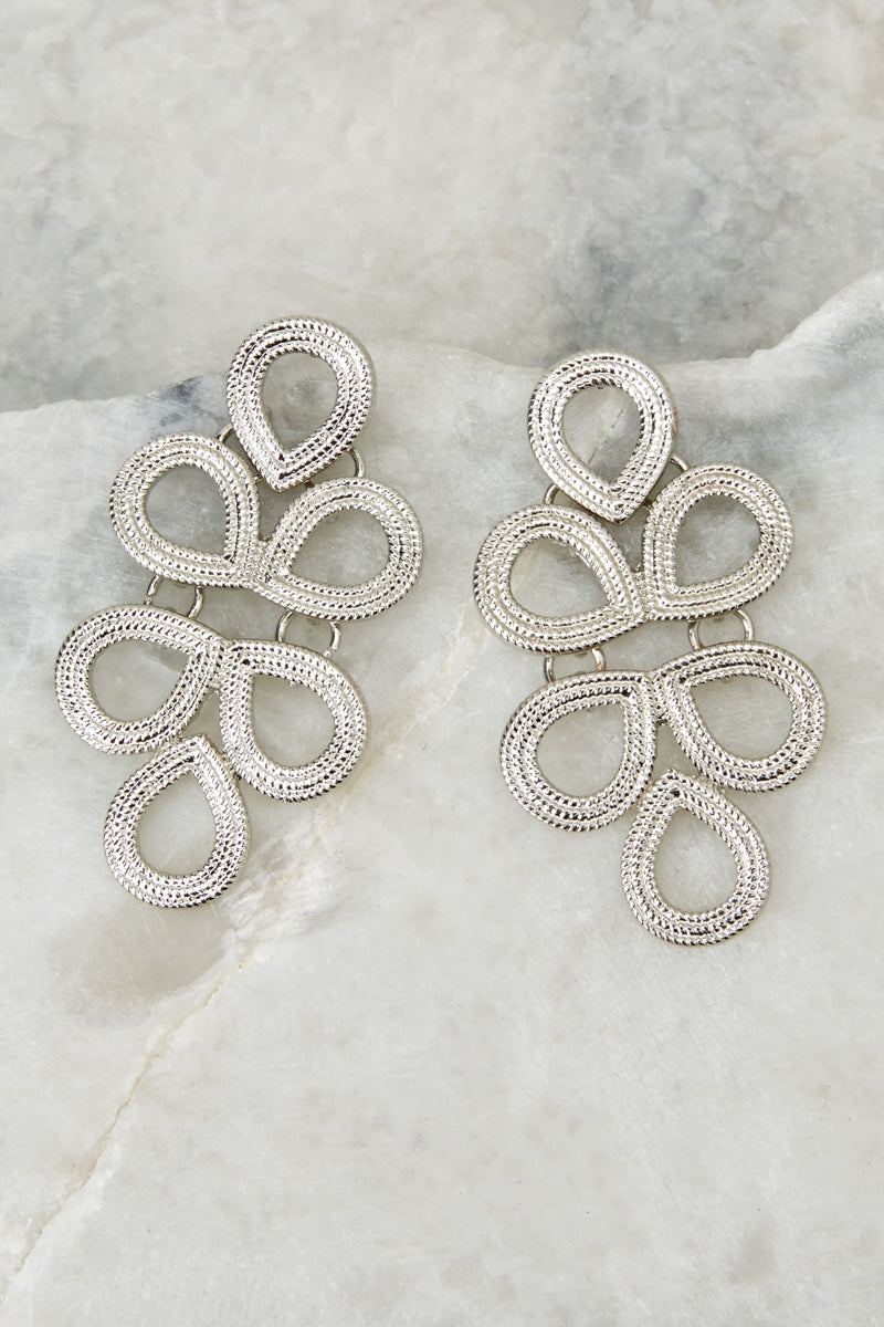1 Catching Looks Silver Earrings at reddressboutique.com