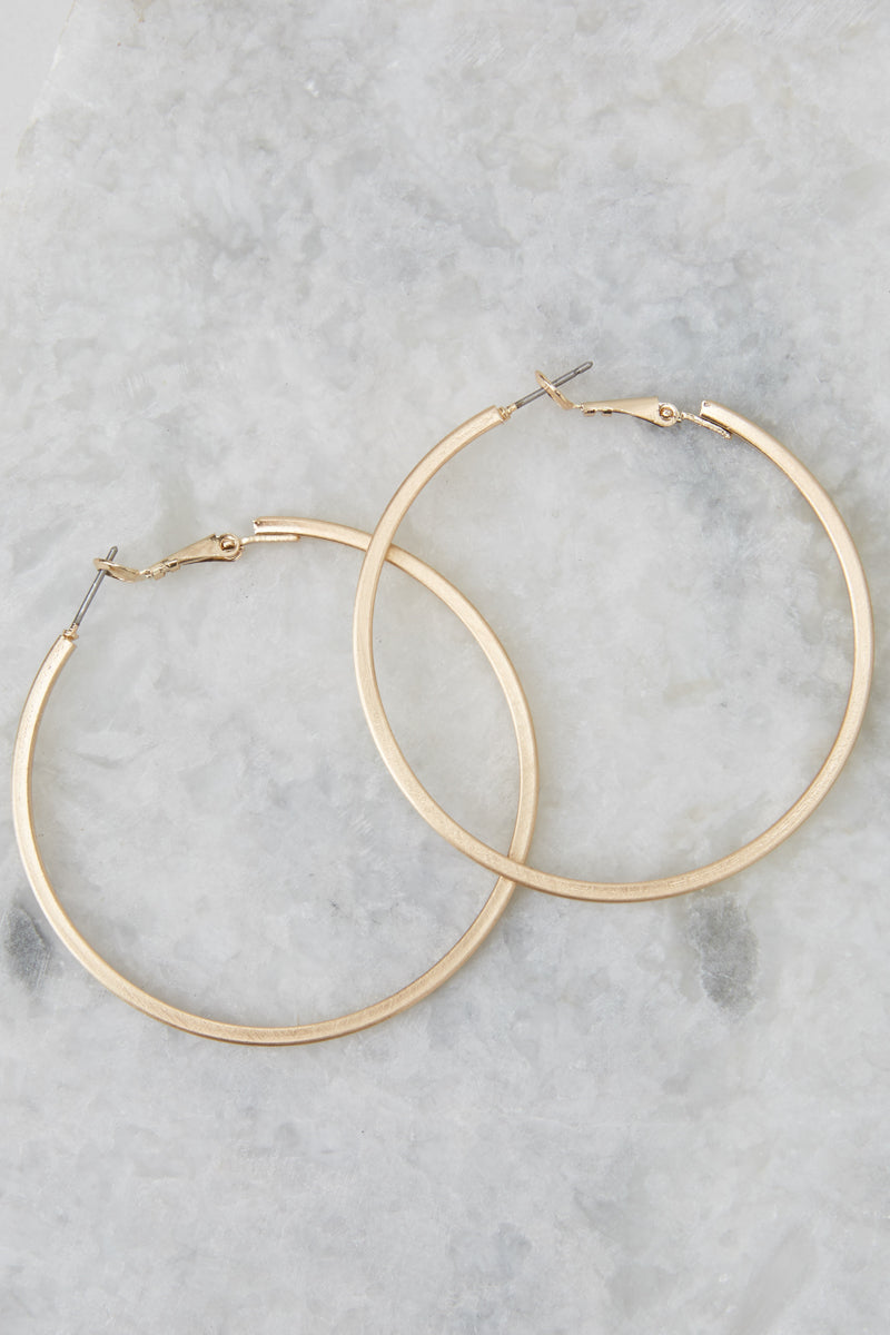 1 Noticing These Gold Hoop Earrings at reddressboutique.com