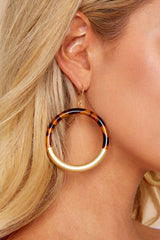 1 Got Away With It Gold And Tortoise Earrings at reddressboutique.com