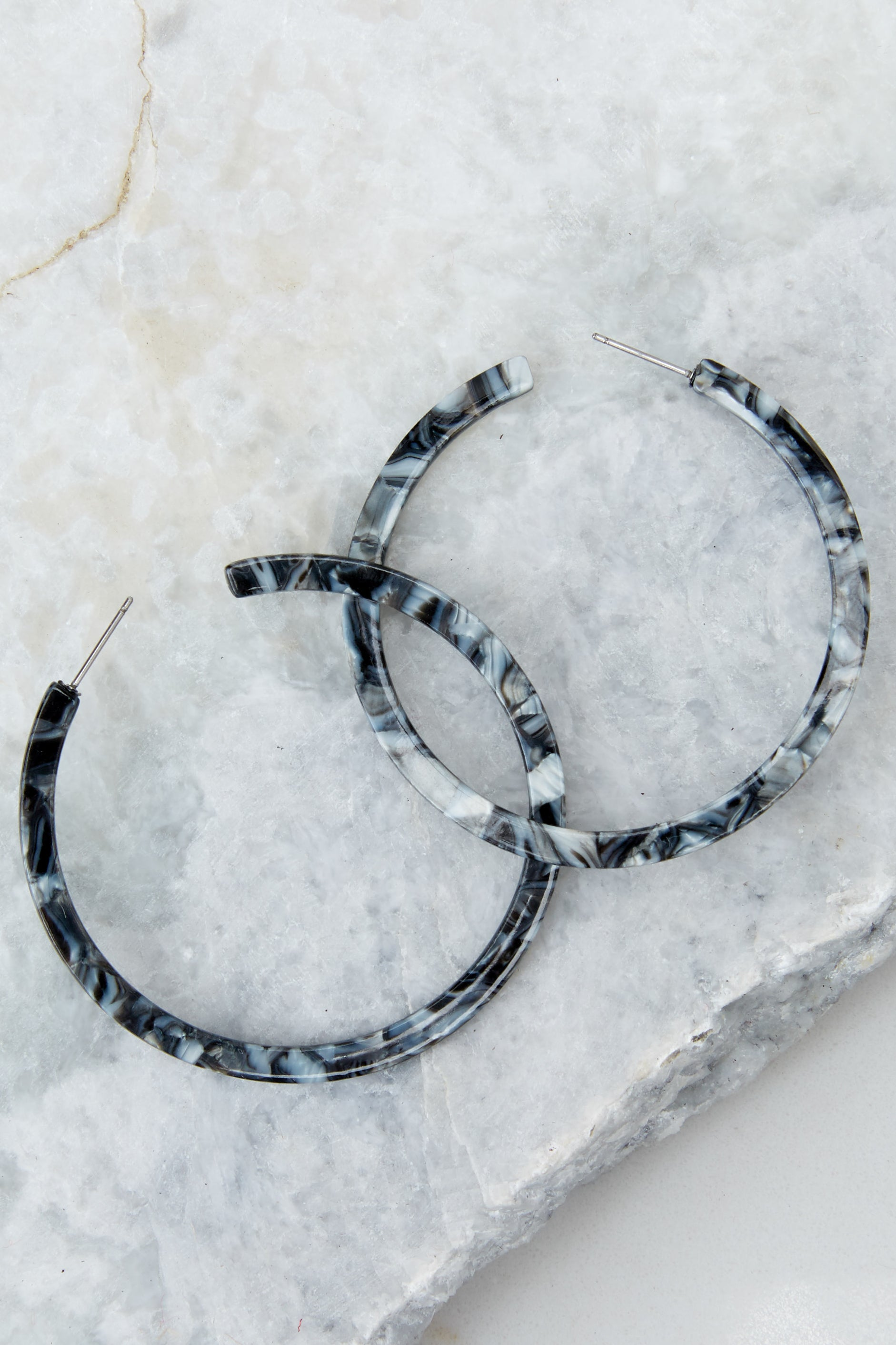 1 Nothing Like It Black Tortoise Hoop Earrings at reddressboutique.com