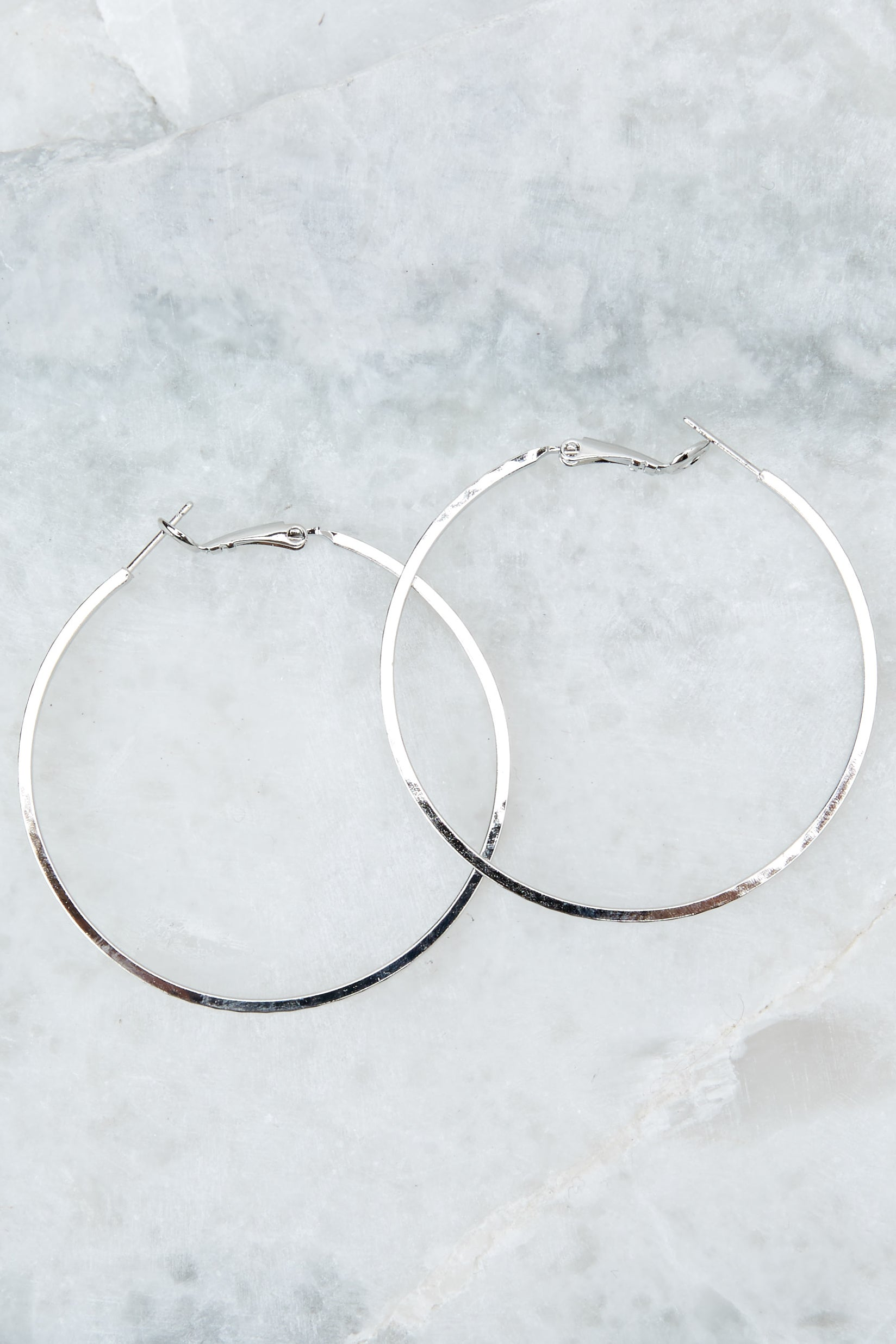 1 Noticing These Silver Hoop Earrings at reddressboutique.com