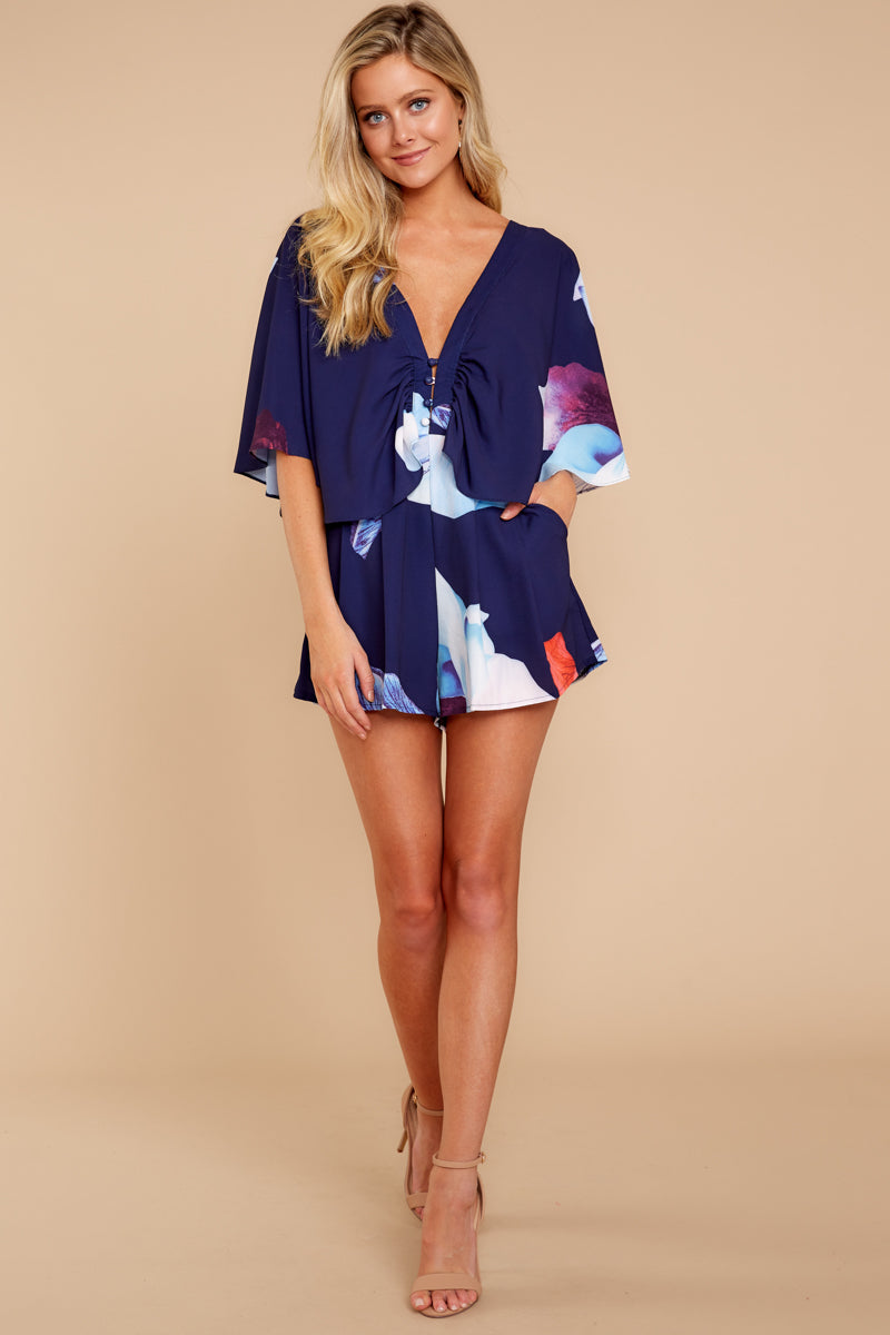8 Can't Forget This Navy Floral Print Romper at reddressboutique.com