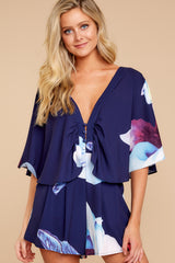 5 Can't Forget This Navy Floral Print Romper at reddressboutique.com