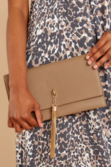 1 Stealing Hearts Brown Tasseled Clutch at reddressboutique.com
