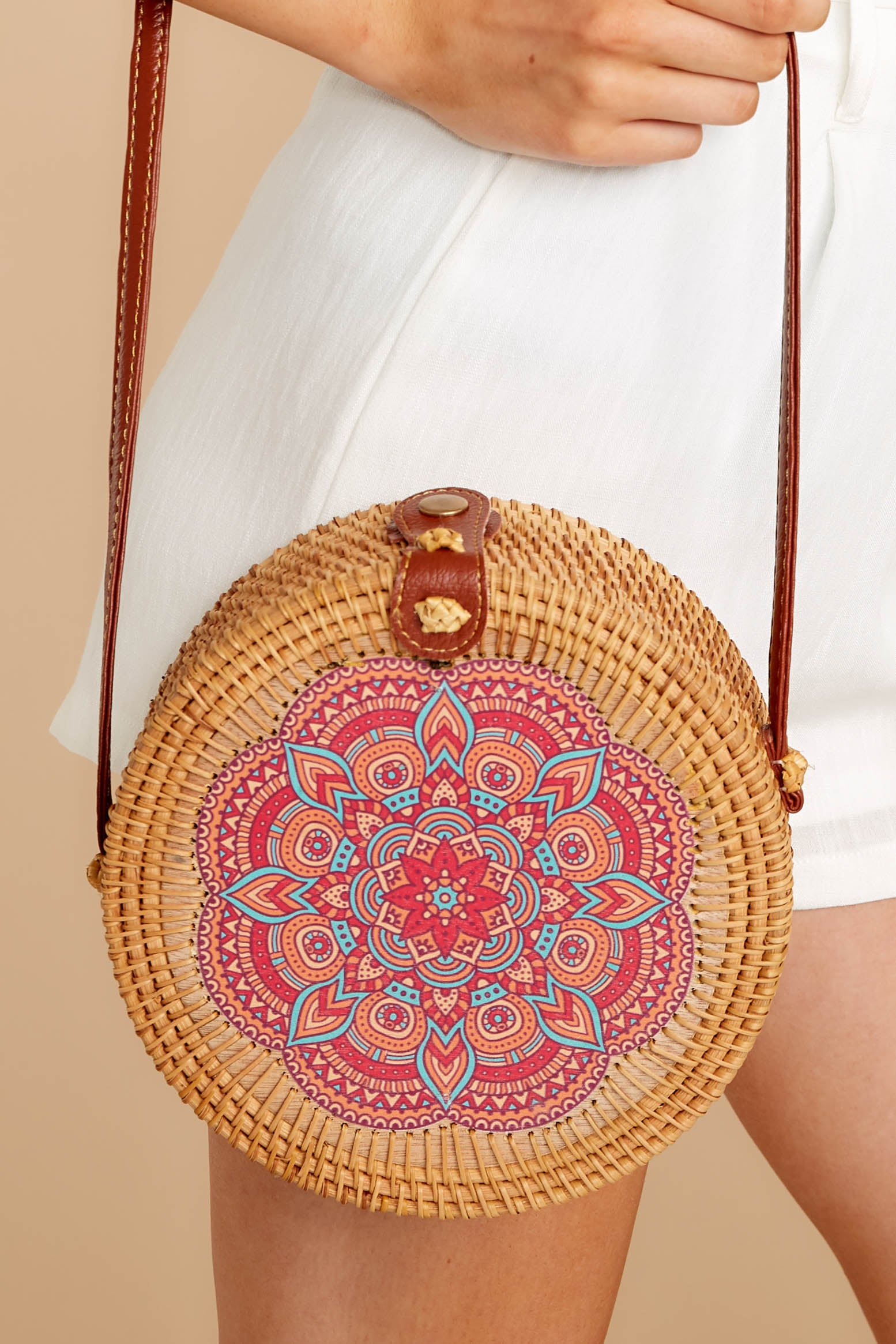1 A Little Charmed Pink Printed Tan Round Bag at reddressboutique.com