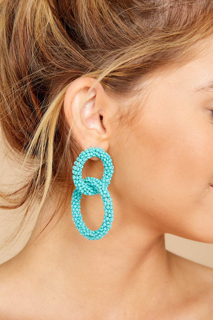 1 She's Famous Turquoise Tasseled Earrings at reddressboutique.com