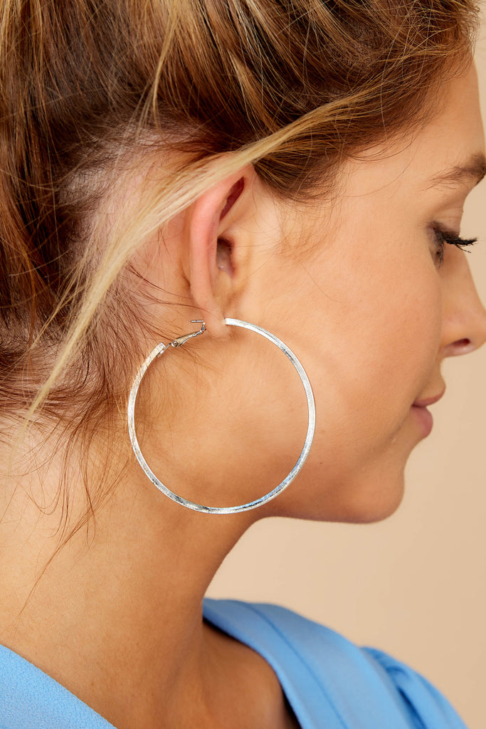 2 Noticing These Silver Hoop Earrings at reddressboutique.com