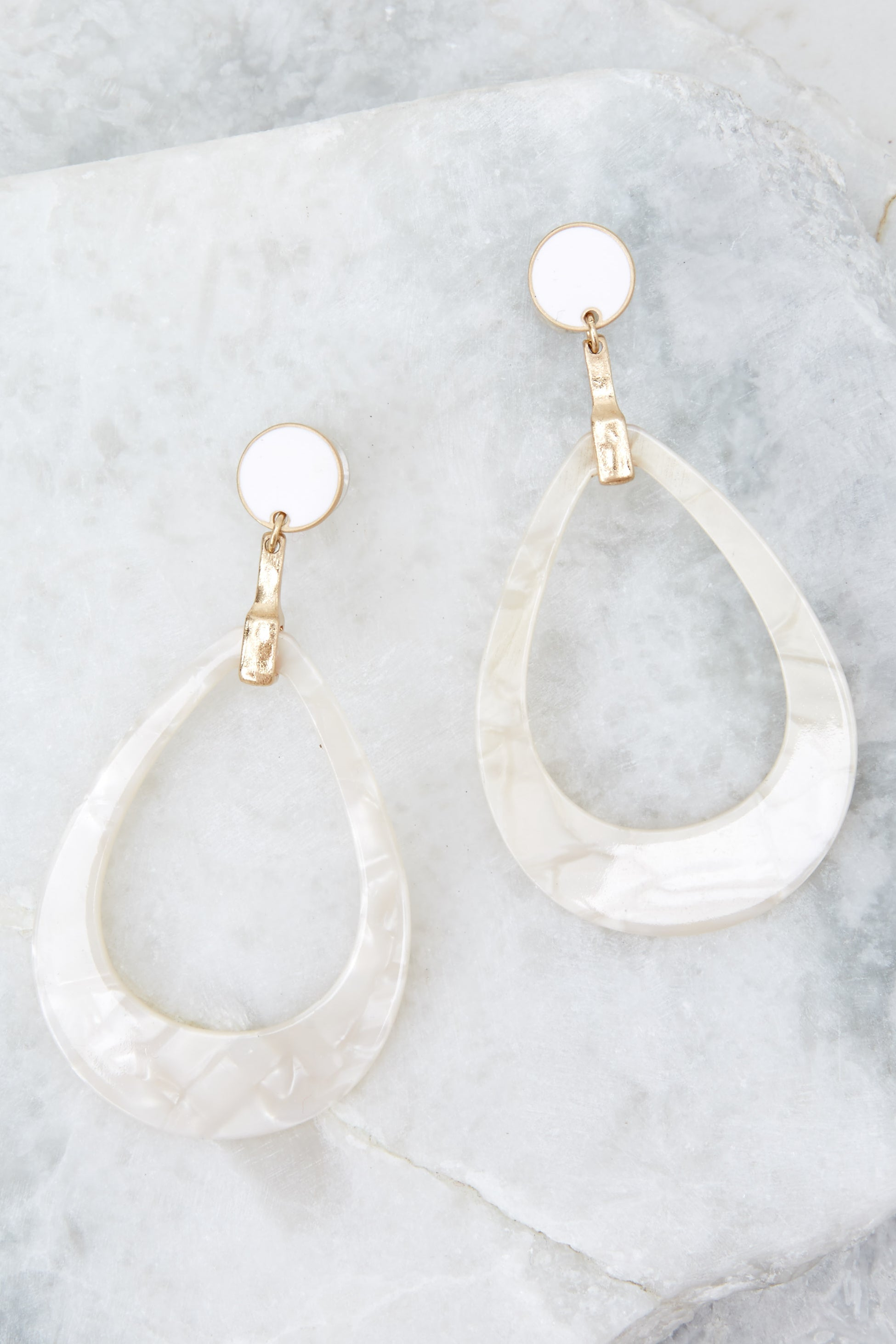 1 Worth It All White Tortoise Earrings at reddressboutique.com
