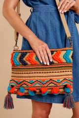 1 Pom It Out Orange Multi Embroidered Clutch at reddressboutique.com