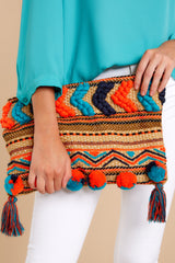 4 Pom It Out Orange Multi Embroidered Clutch at reddressboutique.com