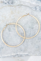 2 Noticing These Gold Hoop Earrings at reddressboutique.com