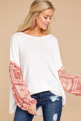 4 Falling For This White And Pink Print Top at reddressboutique.com