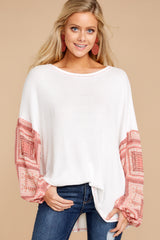 5 Falling For This White And Pink Print Top at reddressboutique.com