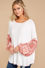 6 Falling For This White And Pink Print Top at reddressboutique.com
