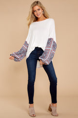 3 Falling For This Navy Print Top at reddressboutique.com