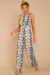 2 Thinking About Running Ivory Snake Print Jumpsuit at reddressboutique.com