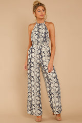 3 Thinking About Running Ivory Snake Print Jumpsuit at reddressboutique.com