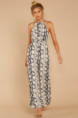4 Thinking About Running Ivory Snake Print Jumpsuit at reddressboutique.com