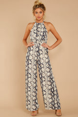 1 Thinking About Running Ivory Snake Print Jumpsuit at reddressboutique.com