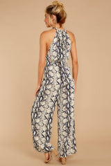 6 Thinking About Running Ivory Snake Print Jumpsuit at reddressboutique.com