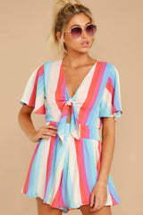 6 Think We Oughta Pastel Rainbow Stripe Romper at reddressboutique.com