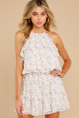 7 A Little Mystery White Floral Print Romper at reddress.com