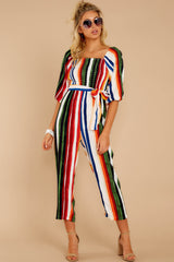 4 Come To Cabo Orange Rainbow Stripe Jumpsuit at reddressboutique.com