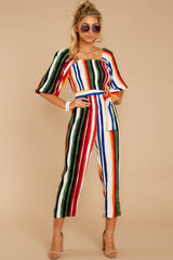 5 Come To Cabo Orange Rainbow Stripe Jumpsuit at reddressboutique.com