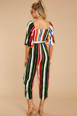 7 Come To Cabo Orange Rainbow Stripe Jumpsuit at reddressboutique.com