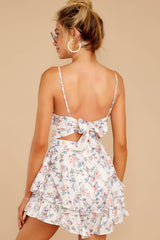 7 All About Love White Floral Print Romper at reddressboutique.com