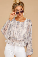 6 Something So Great Blush Multi Snake Print Top at reddressboutique.com